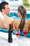 Young couple in jacuzzi. Royalty Free Stock Image