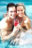 Young couple in jacuzzi. Stock Images