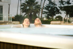 Young couple in a jacuzzi Royalty Free Stock Photography