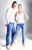 Young couple in jeans standing and posing royalty free stock photo