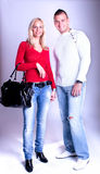 Young couple in jeans standing and posing Stock Photo