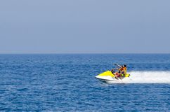 Young Couple on Jet Ski fast ride. Tropical Ocean, Vacation Concept royalty free stock images