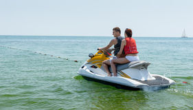 Young couple on a jet ski Stock Image
