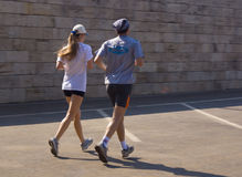 Young couple jogging. Active couple on a sunny day Stock Images
