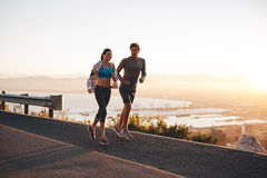 Young couple jogging early in morning Royalty Free Stock Image