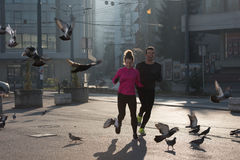 Young  couple jogging Stock Images