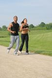 Young Couple Jogging Outdoor at Park Royalty Free Stock Photography