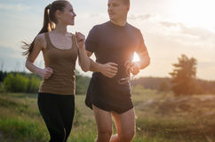 Young couple jogging outdoors Stock Images