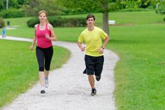 Young couple jogging in park Royalty Free Stock Photos