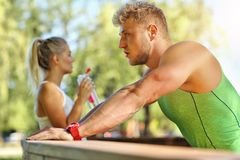 Young couple jogging in park Stock Images