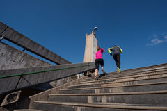 Young  couple jogging on steps Stock Photos