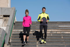 Young  couple jogging on steps Stock Images