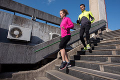Young  couple jogging on steps Royalty Free Stock Photos