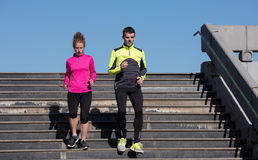 Young  couple jogging on steps Stock Image