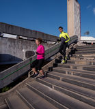 Young  couple jogging on steps Stock Photography