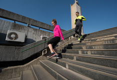 Young  couple jogging on steps Royalty Free Stock Photography