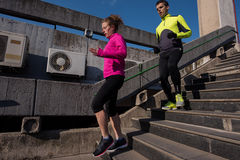 Young  couple jogging on steps Royalty Free Stock Images