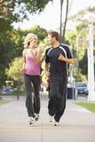 Young Couple Jogging On Street Royalty Free Stock Images