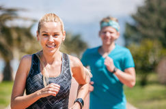 Young couple jogging royalty free stock photos