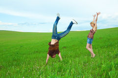 Young couple jump around in the nature Stock Photo