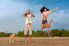 Young couple jumping Stock Images
