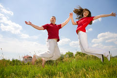 Young Couple -  jumping Stock Photo