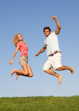 Young couple jumping in air Stock Photography