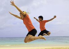 Young couple jumping in the air Royalty Free Stock Image