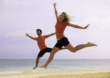 Young couple jumping in the air Stock Photography