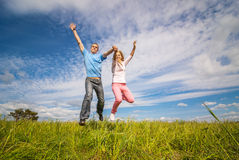 Young couple jumping Royalty Free Stock Image