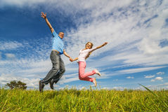 Young couple jumping Royalty Free Stock Photos