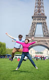 Young couple jumping near Eiffel tower Royalty Free Stock Image