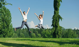 Young couple jumping outside Royalty Free Stock Photo