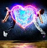 Young couple jumping. To heart symbol Royalty Free Stock Photo