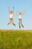 Young couple jumps Stock Photos