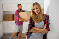 Young couple just move to their new apartment. Beautiful girl an Stock Photos