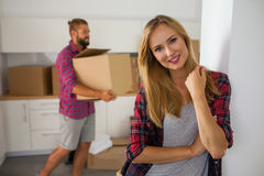 Young couple just move to their new apartment. Beautiful girl an Royalty Free Stock Photos