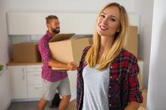 Young couple just move to their new apartment. Beautiful girl an Stock Photography