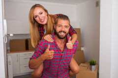 Young couple just move to their new apartment. Boy carrying girl Stock Photo