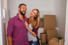Young couple just move to their new apartment. They are still unpacked Stock Photos