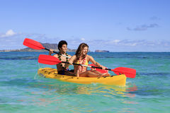 Young couple with a kayak Royalty Free Stock Images