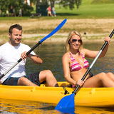 Couple sitting in kayak on a sunny day Stock Image