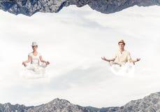 Young couple keeping mind conscious. Stock Photos
