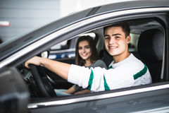 Young couple with keys to new car Stock Photo