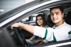 Young couple with keys to new car Royalty Free Stock Photo