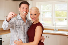 Young Couple With Keys To New Home Stock Images