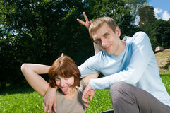 Young couple kidding. Young lovers having fun in the park Royalty Free Stock Photos