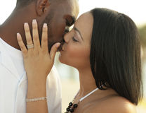 Young couple kissing. Image of a young multiracial couple kissing Stock Photography