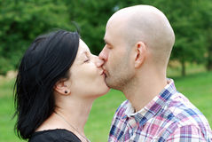 Young couple kissing Stock Photos