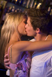Young couple kissing. In a nightclub Royalty Free Stock Photos